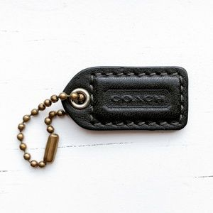 Small black leather Coach dog tag keychain